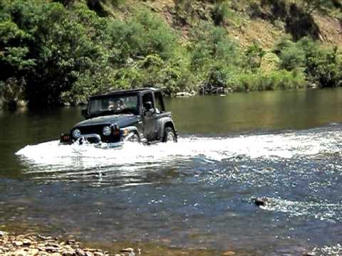 jeep on the river